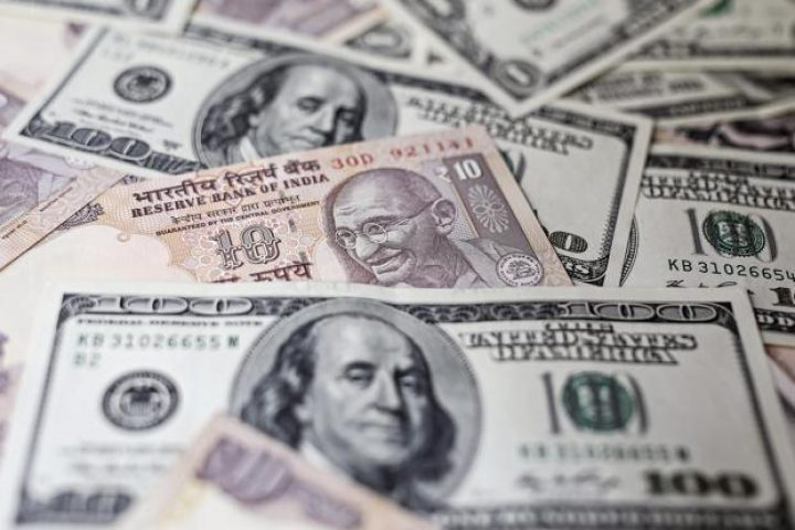 Rupee strengthens against US dollar, hits one-week high ahead of key data