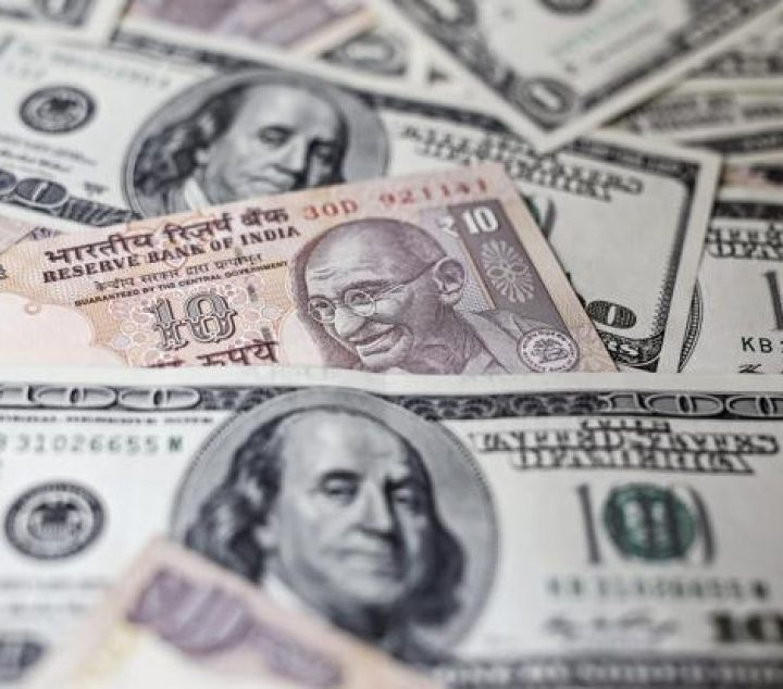 Rupee opens marginally higher against US dollar