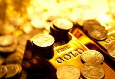 Gold Hits 2-Mo. High On Safe-Haven Demand, Weak U.S. Dollar