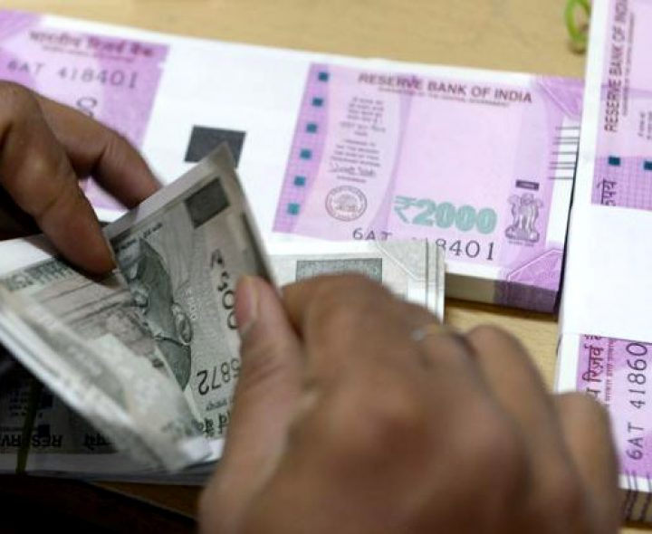 Rupee trades marginally higher against US dollar