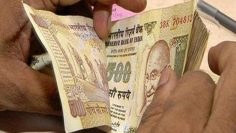 Rupee down 5 paise against dollar in early trade