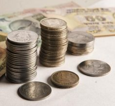 Rupee slips from early gains, down 12 paise